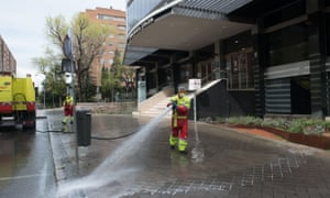 Environment workers disinfect the entrance of the Hotel Colon in Madrid.