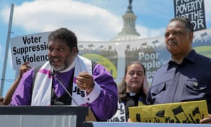 The Rev William Barber, left, with the Rev Jesse Jackson at a Poor People's campaign rally in Washington DC on 21 May.