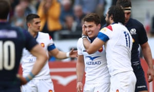 France's Yoann Huget celebrates his try with Antoine Dupont.