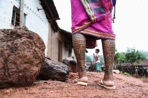 Sumintra, 25, from Bona village in Baiga Chak in Dindori, has tattoos across her legs and arms