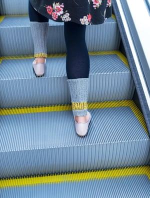 Nina on an escalator, 2018