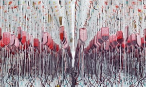 Rows of donated human blood hang from hooks as they undergo processing at a blood centre.