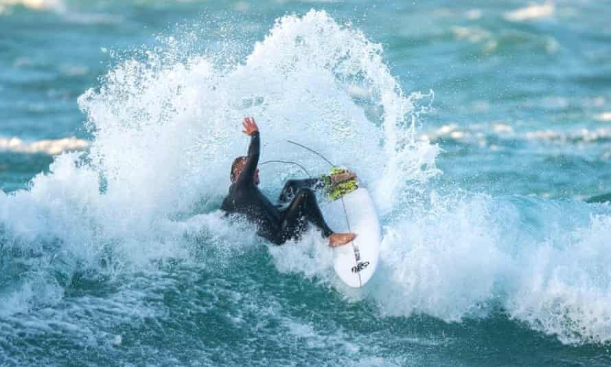 Sam Smart, co-owner of Smart surf school, surfing in Cornwall during the second lockdown.