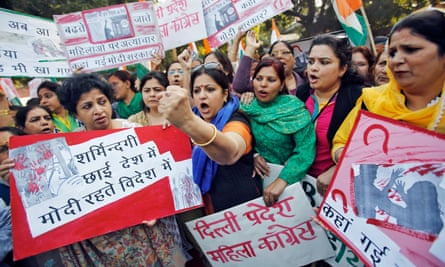 Members of All India Mahila Congress protest the rape of a passenger by her driver in New Delhi in 2014. The case prompted India to temporarily ban Uber in the capital.