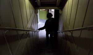 Heidi Ross walks down the stairs at the transitional housing facility in Anchorage, Alaska.