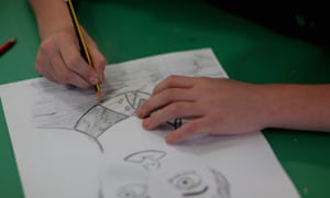 A child drawing in school