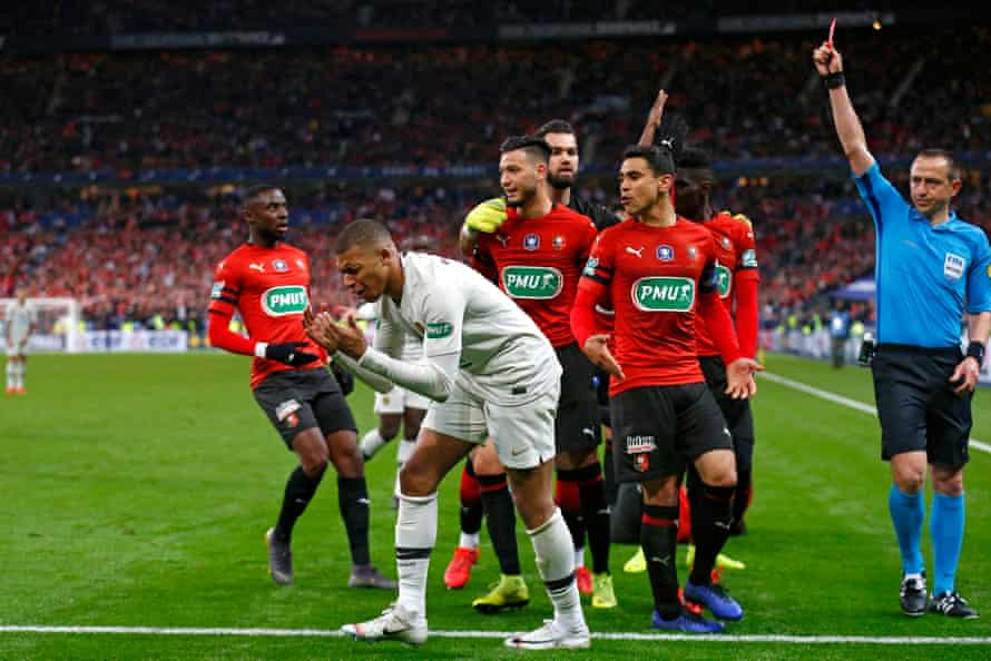 Kylian Mbappé reacts with despair to being shown the red card