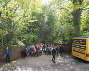 Magical Mystery Tour bus passengers gather for a photograph outside Strawberry Fields, Liverpool