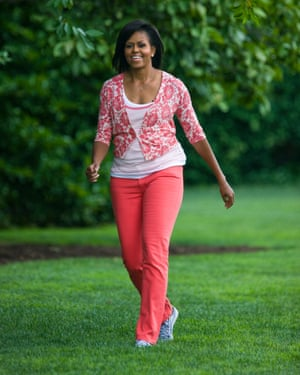 Michelle Obama walks to her vegetable garden on the south lawn of the White House in Washington.