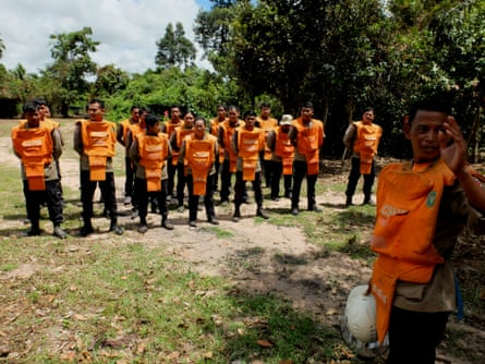 Members of Cambodia Self Help Demining (CSHD) assemble before performing checks for a controlled explosion.