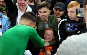 A young fan can't hide his delight after Ederson gives him his shirt.
