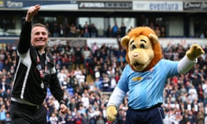 Bolton manager Phil Parkinson celebrates winning promotion with club mascot Lofty.