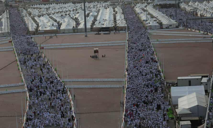 Pilgrims walk from their tents in Mecca