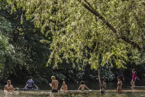 Members of the public cool off in the River Lea as temperatures reached  28C ( 82.4 F) in the UK.