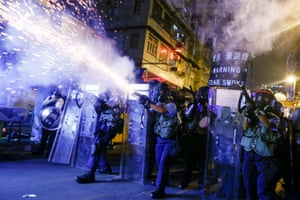 Police fire teargas at protesters in Sham Shui Po, Hong Kong