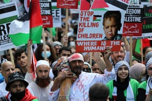 Pro-Palestinian protesters stage a solidarity demonstration with Palestine outside Downing Street as G7 country leaders gather in Cornwall.