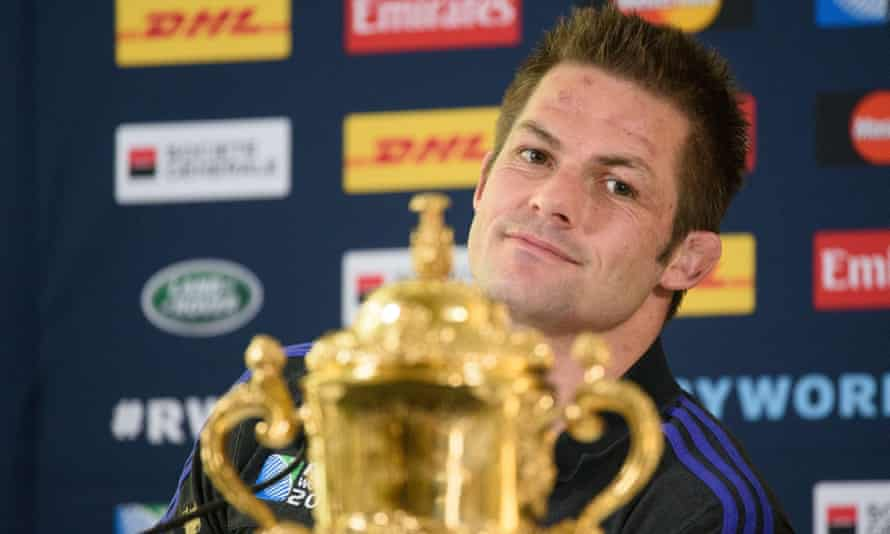 Richie McCaw sits with the Webb Ellis Cup