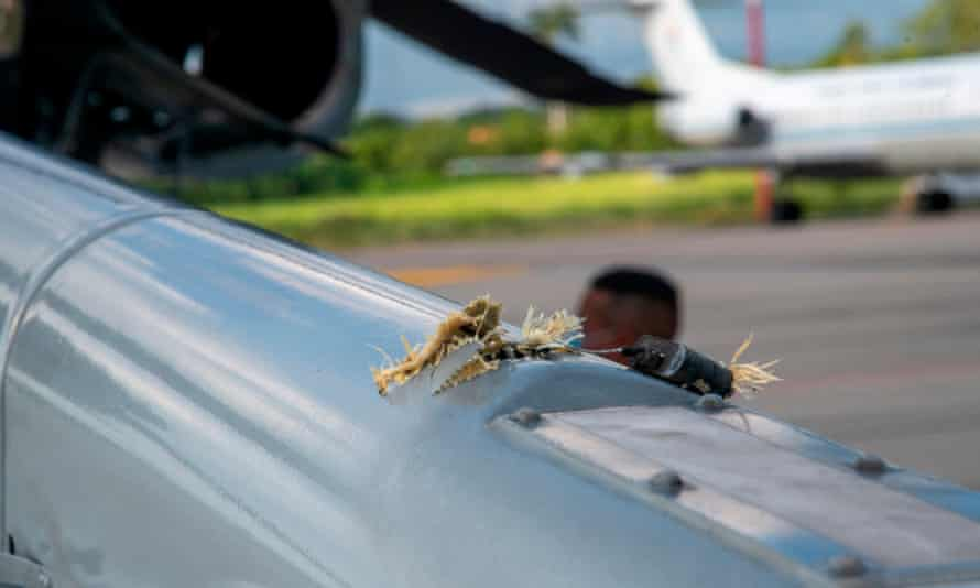 Bullet damage to the helicopter carrying the president of Colombia and other top officials.