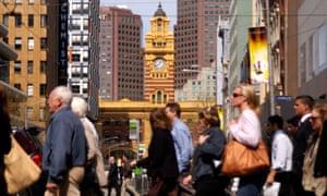People cross a street in Melbourne