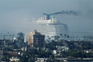 Carnival Miracle sits in the fog at Long Beach port, California, 23 April 2020