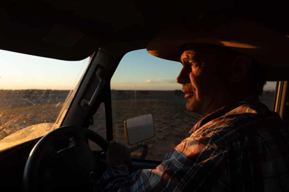Kidd drives his vehicle across his property at dusk
