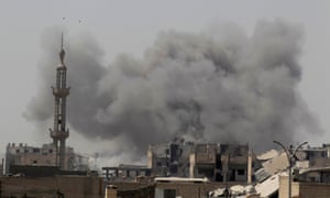 Smoke rises after an airstrike in Raqqa, Syria