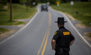 An officer works a checkpoint on 14 June 2015 in Cadyville, New York