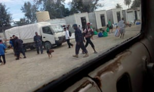 PNG officials, wearing army fatigues, inside the closed detention centre on Manus