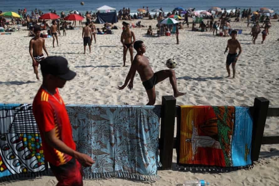 People play football at Ipanema beach in Rio last week.