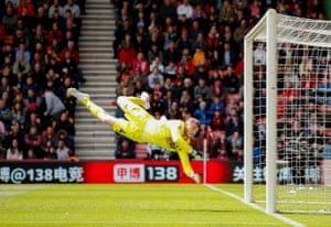 Bournemouth's Mark Travers leaps into action as nine-man Tottenham suffer defeat on the road. An injury-time goal from Nathan Ake condemned Spurs after Son Heung-min and Juan Foyth were both sent off in the space of five minutes.