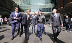 Prime Minister Malcolm Turnbull (2nd left) walks with Minister for Police Troy Grant, and NSW Police Commissioner Mick Fuller along Pitt St Mall in Sydney.