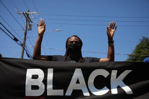 Protesters with the Burlington-Alamance March For Justice and Community march in Graham, North Carolina on 11 July.