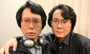 Japan - Android - Scientific Research<br>20 Jul 2006, Keihanna Science City, Kyoto, Japan --- Robotics scientist Dr. Hiroshi Ishiguro poses with 'Geminoid' a prototype of a Doppelganger-type android, modeled after himself, at the ATR Intelligent Robotics and Communication Laboratories. Geminoid, named after the twin-gods Gemini, is the first android to be modeled after a real person, including subtle body movements and personality traits of the individual. The android will be used to research questions such as how to capture, revive and transmit a living person's 'sense of presence' or atmosphere, into an android 'twin'.  --- Image by   Evertt Kennedy Brown/epa/Corbis