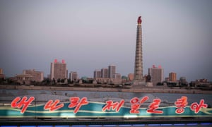 The Juche Tower, a monument to the ideas of Kim Il-sung, is seen over the side of the Taedonggang floating restaurant in Pyongyang, North Korea.
