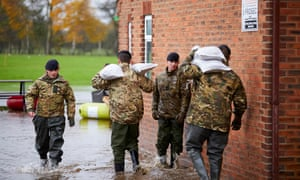 Soldiers drop sandbags in South Yorkshire, where the Environment Agency warned of continued problems.