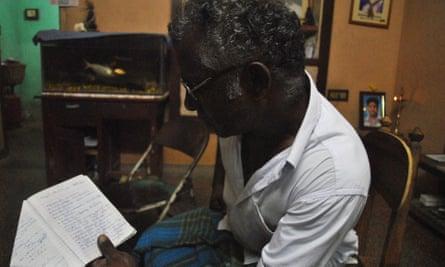 Jawahar's father K. Kumaran reading from his son's diary