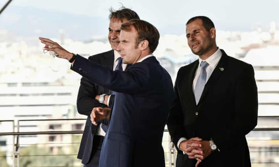 The Greek prime minister, Kyriakos Mitsotakis (left), speaks with the French president, Emmanuel Macron (centre), and Malta's prime minister, Robert Abela, on the sidelines of the EUMed9 Summit, in Athens