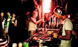 A DJ plays and revellers party at a New Year's Eve party at Rancho Itaúna, Santa Teresa, Costa Rica.