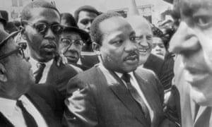 Dr Martin Luther King (center) surrounded by leaders of the Memphis sanitation strike.