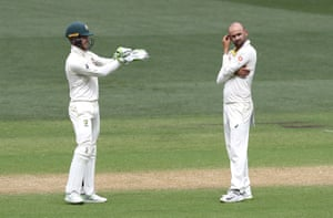 Tim Paine and Nathan Lyon contemplate the challenges of dismissing India's batsmen at Adelaide Oval.