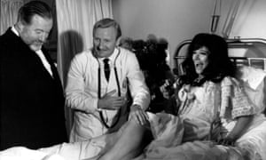 Fenella Fielding, with James Robertson-Justice (left) and Leslie Phillips in the 1966 film Doctor in Clover.