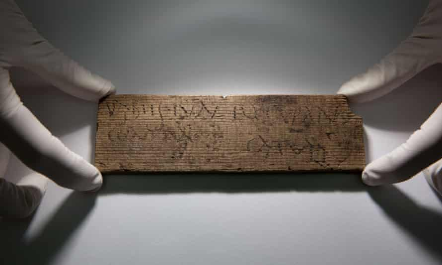 """A Roman waxed writing tablet dated AD 80-90/5, which translated reads: """"You will give [this] to Junius the cooper, opposite [the house of] Catullus""""."""