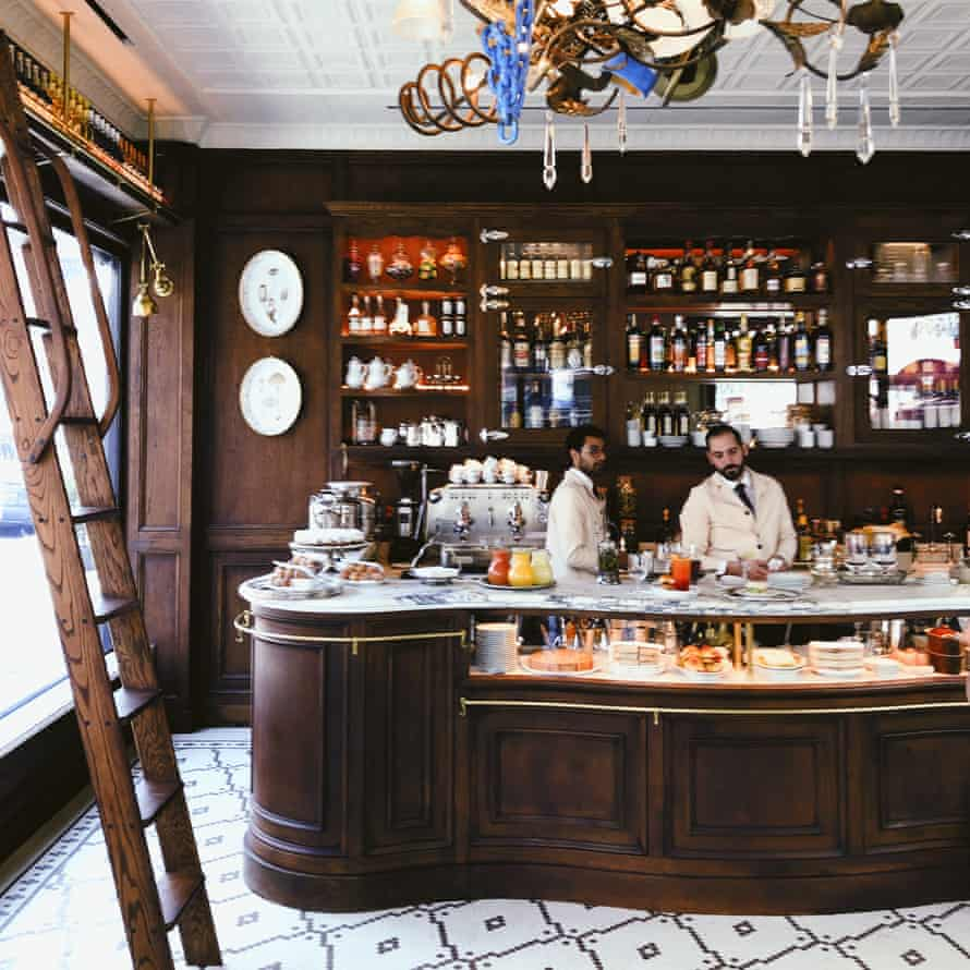 Interior of the bar, with two bar staff, at Bar Pisellino 52 Grove Street, New York, NY, US.