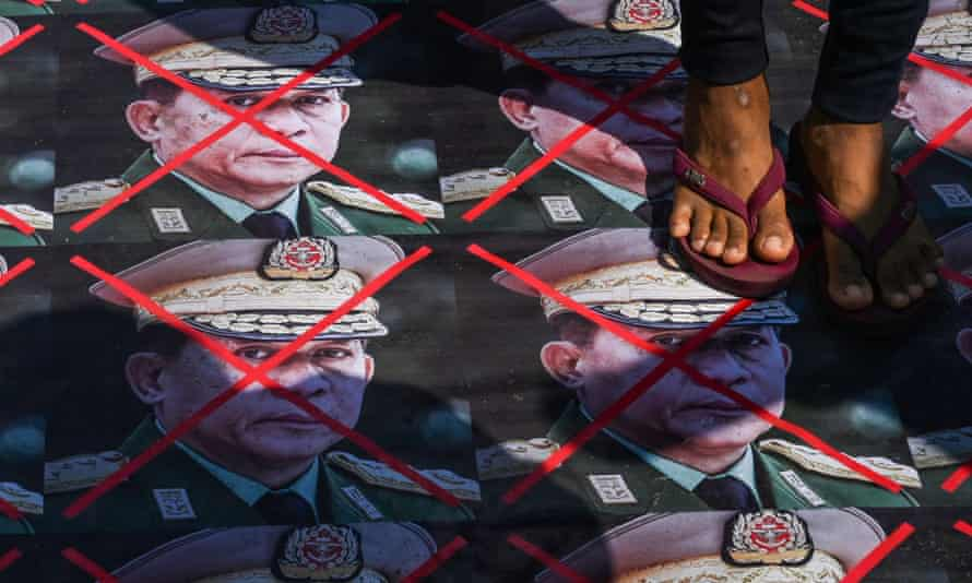 Portraits of Min Aung Hlaing on street and protester's feet