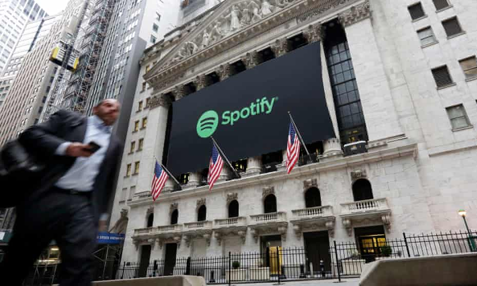 A Spotify banner adorns the facade of the New York Stock Exchange.