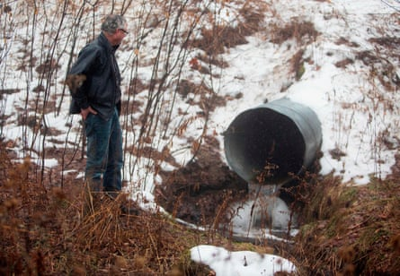 David Huff, chairperson of the zoning and planning commission for Osceola Township, stands before Chippewa Creek, shown flowing through a culvert. Residents in the tiny Osceola Township, Michigan complained the Swiss company's water extraction techniques awere ruining the environment.