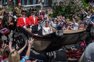 Crowds cheer as the newlyweds parade through Windsor
