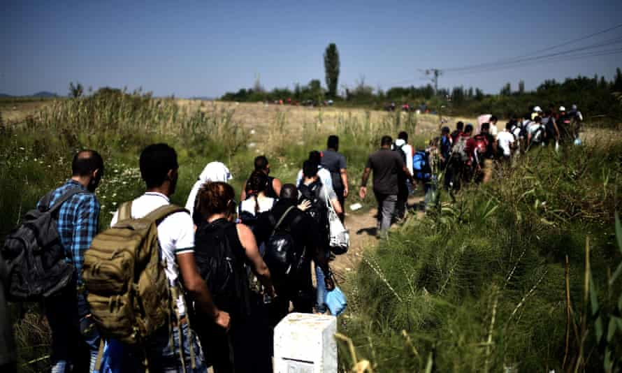 Syrian migrants after crossing the border between Macedonia and Serbia in August 2015