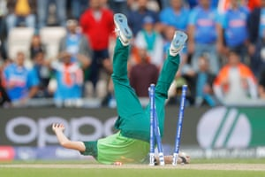 Chris Morris of South Africa takes a catch off his own bowling to dismiss MS Dhoni before falling onto the stumps at The Ageas Bowl.