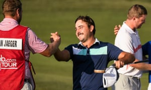 Stephan Jaeger is congratulated by his caddie after shooting a record score of 58 in Hayward, California.